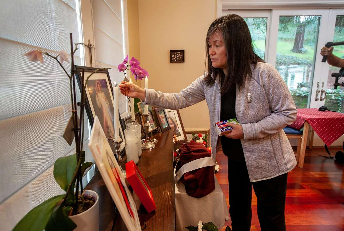 At home Seong Brown lights a candle at the alter she made for her daughter. Elizabeth's ashes are in the red box with the cross Challenges of a healthcare crisis. Elizabeth Morgan Brown hung herself but lived with serious brain damage until she died at home.