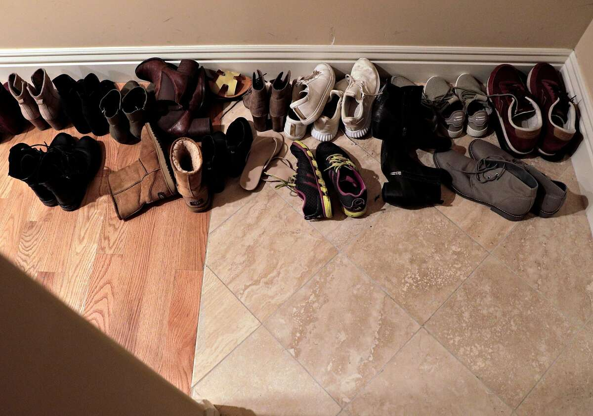 Housemates' shoes are arranged near the front door of their Bungalow, co-living home in Oakland, Calif., on Monday, February 4, 2019. Bungalow is a co-living startup that leases big houses and then rents individual rooms that share a common spaces like kitchen, living room, and bathrooms.