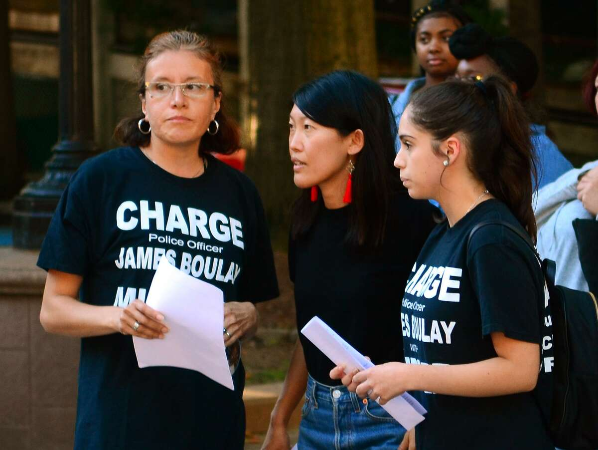 Justice for Jayson Coalition organizers Teresa Sandoval, left, Jeannia Fu, center, and Jazmarie Melendez during a September 2018 rally.