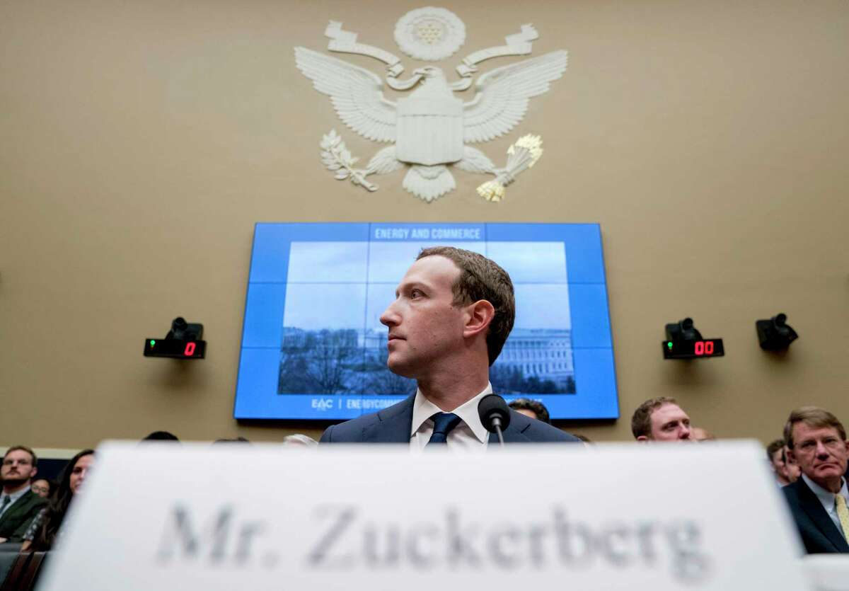 FILE - In this April 11, 2018, file photo Facebook CEO Mark Zuckerberg arrives to testify before a House Energy and Commerce hearing on Capitol Hill in Washington. Zuckerberg?s new ?privacy-focused vision? for Facebook looks like a transformative mission statement for the much-criticized social network. But critics say the announcement obscures Facebook?s deeper motivations: To expand lucrative new commercial services, continue monopolizing the attention of users and to develop new data sources for tracking people. (AP Photo/Andrew Harnik, File)
