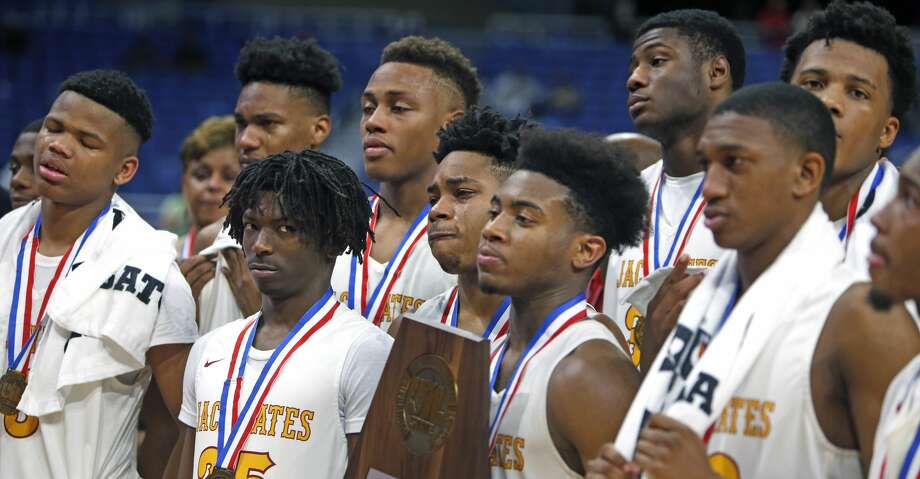 Houston Yates players try to hold back tears after accepting their trophy. UIL boys basketball 4A State semi-final between Houston Yates and Oak Cliff on Friday, March 8, 2019 at the Alamodome in San Antonio, Texas. (Ron Cortes/ Special Contributor) Photo: Ronald Cortes/Contributor/Ron Cortes