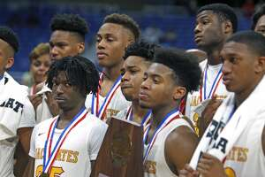 Houston Yates players try to hold back tears after accepting their trophy. UIL boys basketball 4A State semi-final between Houston Yates and Oak Cliff on Friday, March 8, 2019 at the Alamodome in San Antonio, Texas. (Ron Cortes/ Special Contributor)