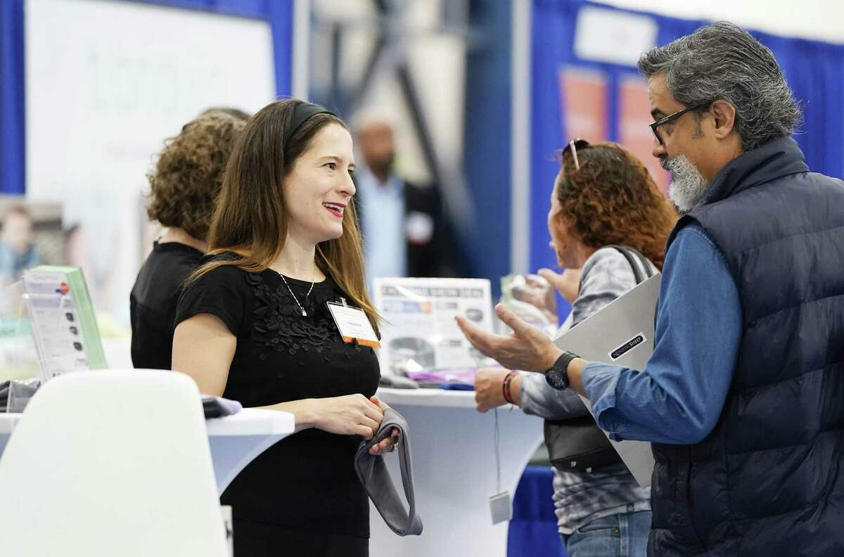 Amanda Austin, marketing manager for Acoustic Sheep, talks about the company's product at the Sleep Show hosted by the National Sleep Foundation at George R. Brown on Friday, March 8, 2019 in Houston. Acoustic Sheep, based in Erie, Penn., makes headband headphones made for sleeping.