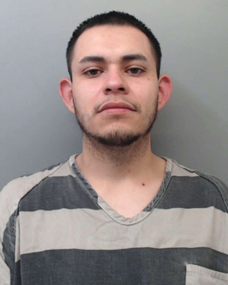 Raul Garcia, 26, was charged with evading arrest with a motor vehicle, resisting arrest, possession of marijuana and possession of a controlled substance. Photo: Webb County Sheriff's Office