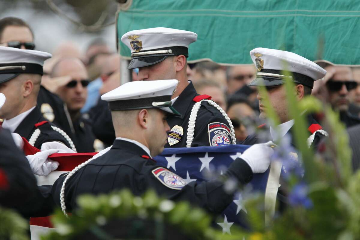 The United States flag is folded after being removed from the casket of Midland Police Department Officer Nathan Heidelberg, March 8, 2019, in Greenwood. James Durbin / Reporter-Telegram