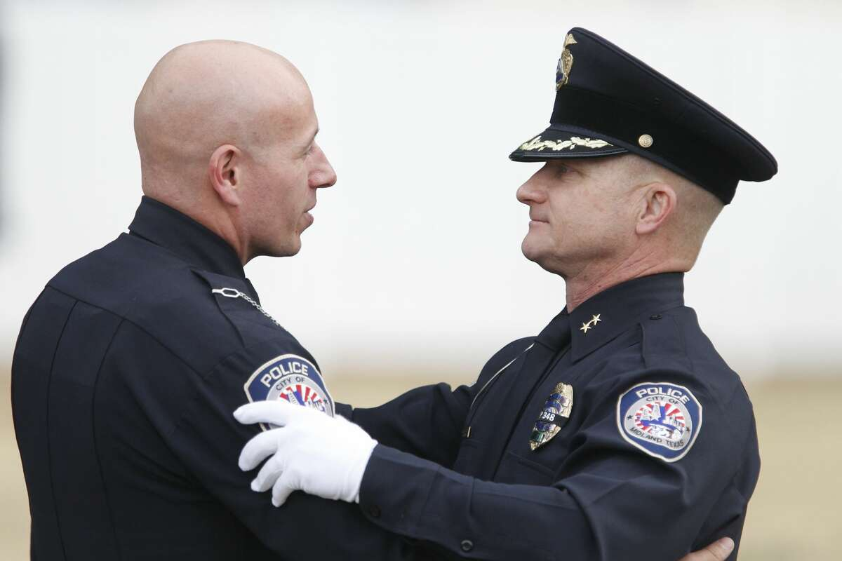 Midland Police Chief Seth Herman (right) embraces Officer Camilo Fonseca after a funeral for Midland Police Department Officer Nathan Heidelberg, March 8, 2019 in Greenwood. James Durbin / Reporter-Telegram