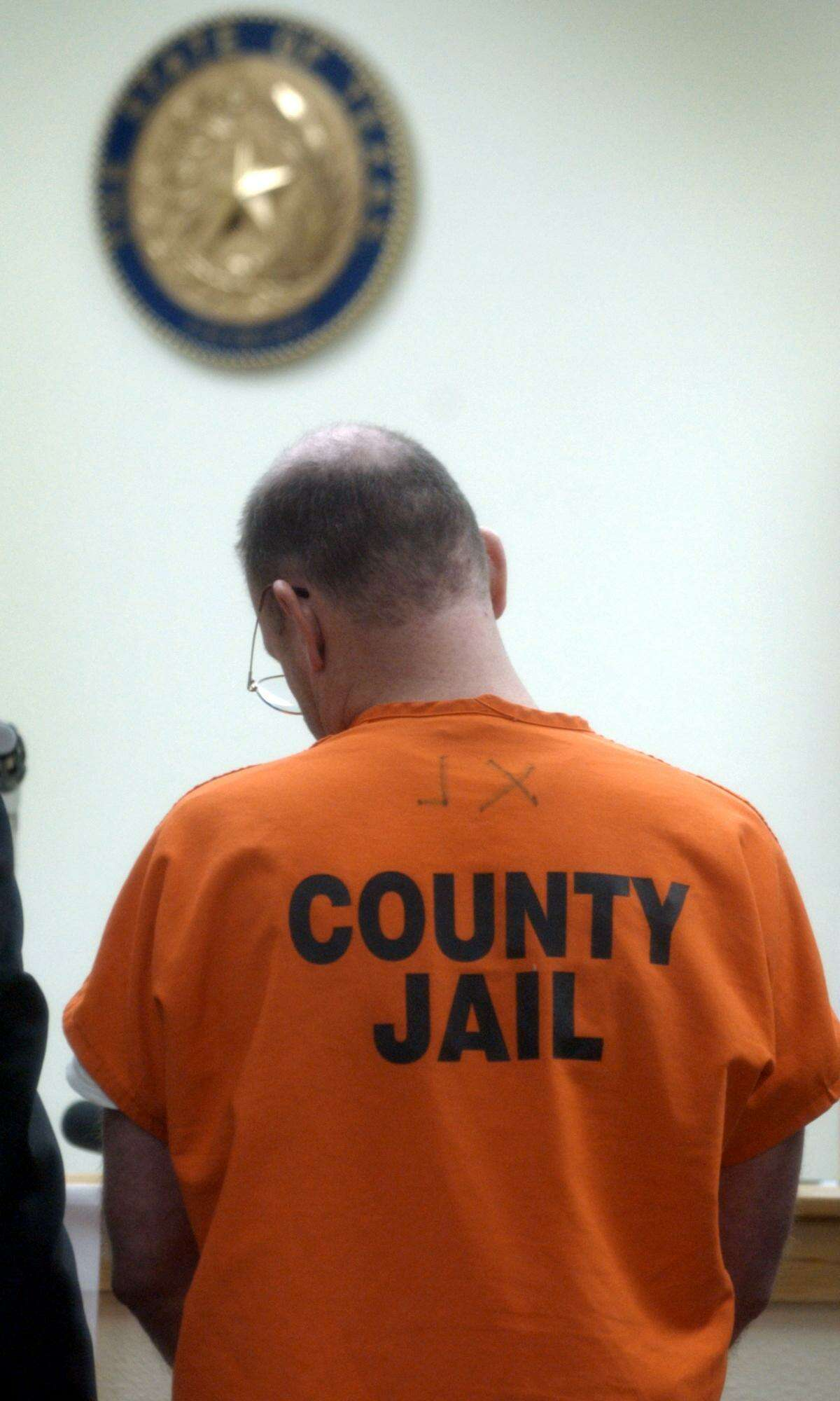 Richard McFarland, suspect in the death of his wife Susan McFarland, appears before Judge Sid Harle in 2002.