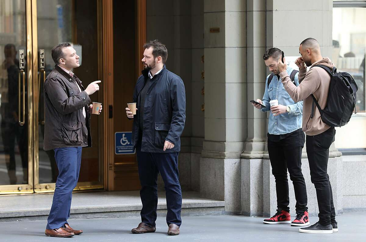 Michael Grant (left) and Sebastian Sutherland (middle) are friends catching up while having Blue Bottle coffee on Bush at Sansome streets on Friday, March 8, 2019, in San Francisco, Calif.