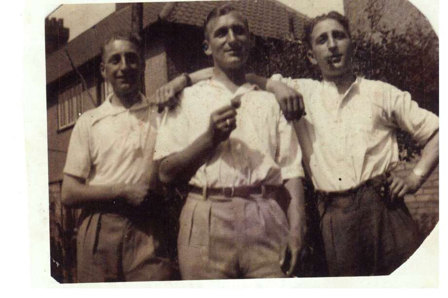 British relatives of the family of Eric Collings, who resided in Torrington, are hoping a family member here in the U.S. will be interested in receiving a collection of photographs they found. From left are brothers Gordon, Eric and Alan Collings. Photo: Contributed Photo /