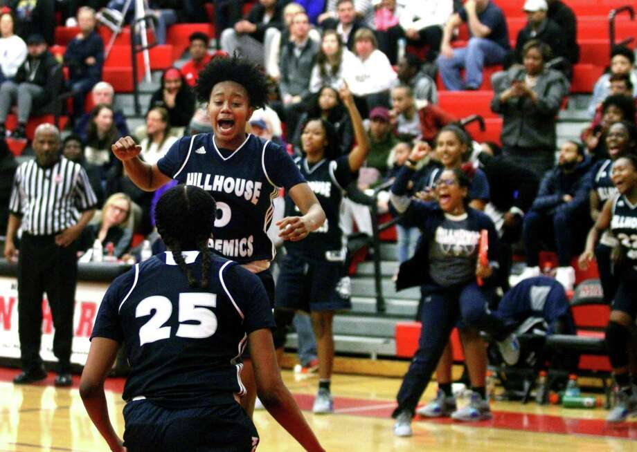 Hillhouse's Tyree Allen Chappell (0) and Tanayja London (25) celebrate their win over Notre Dame-Fairfield on Friday night. Photo: Christian Abraham / Hearst Connecticut Media / Connecticut Post