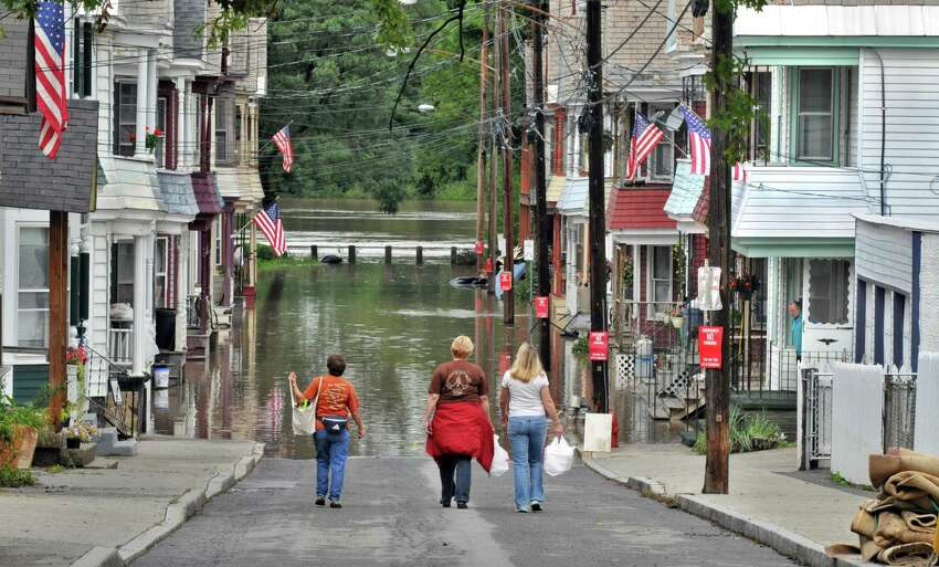 Residents keep a wary eye on Mohawk River flood levels on Ingersol Avenue in Schenectady's Stockade area Thursday Sept. 08 (John Carl D'Annibale / Times Union)