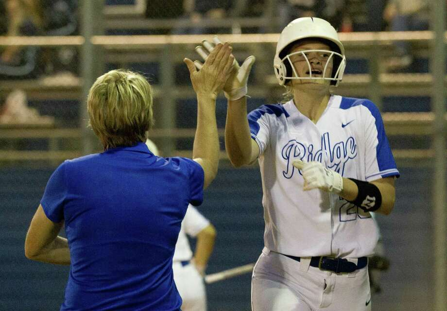 Brittany Cobb of Oak Ridge gets a high-five from head coach Stephani Rougeau after scoring during the second inning of a District 15-6A high school softball game at Oak Ridge High School on Friday. Photo: Jason Fochtman, Houston Chronicle / Staff Photographer / © 2019 Houston Chronicle
