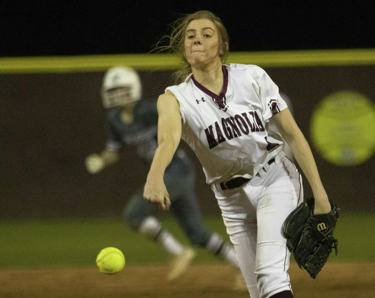 Magnolia pitcher Sawyer Jordan (8) throws the ball at the top of the seventh inning of a District 19-5A softball game at Magnolia High School.