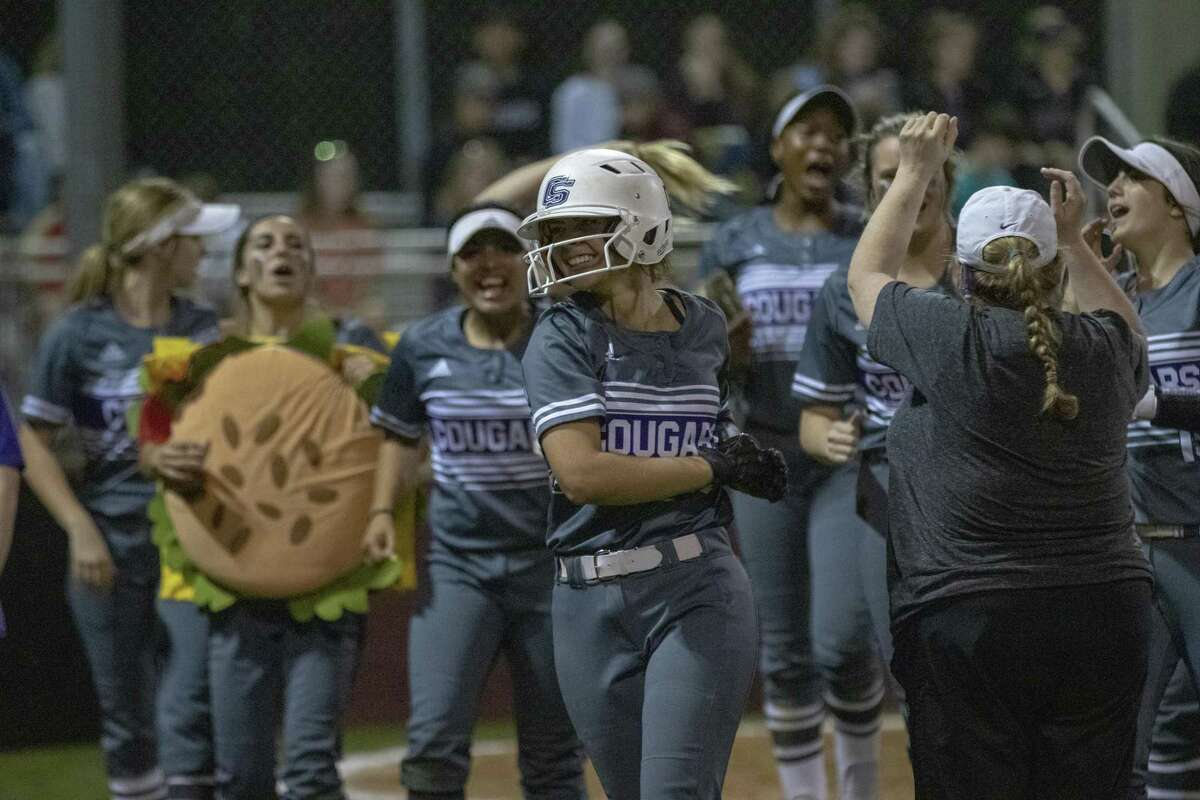 College Station catcher Grace Davis (5) returns to the dugout after hitting a home run during a District 19-5A softball game at Magnolia High School.