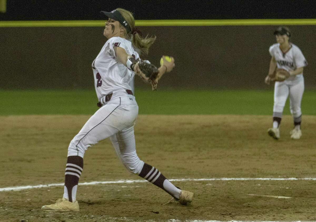 Magnolia pitcher Maddie Biehl (2) throws the ball during a District 19-5A softball game at Magnolia High School.
