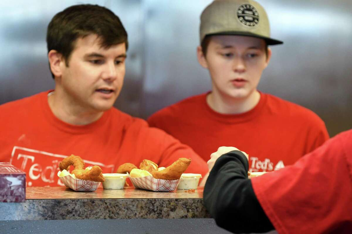 Fish sandwiches are served up from the kitchen at Ted's Fish Fry during a busy first Friday of the holy Christian season of Lent on March 8, 2019, on Wolf Road in Colonie, N.Y. Fish fries can draw a large crowd during Lent when those that observe abstain from meat on Friday during the 40-day Lenten period. (Will Waldron/Times Union)