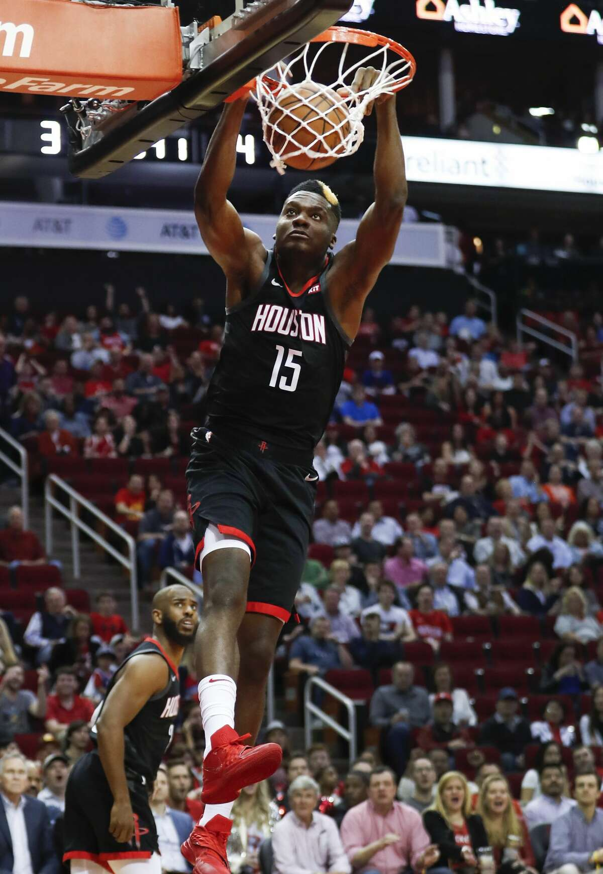 Houston Rockets center Clint Capela (15) scores on a break away dunk against the Philadelphia 76ers during the first half of an NBA basketball game at Toyota Center on Friday, March 8, 2019, in Houston.
