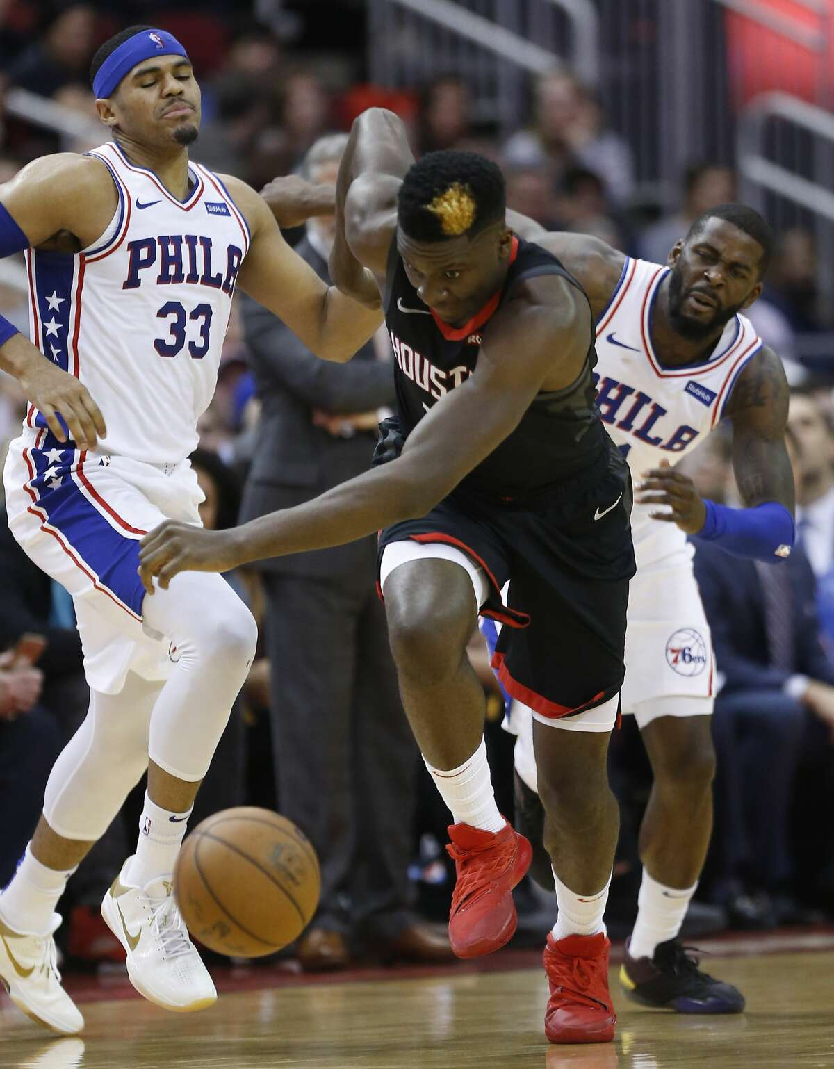 Houston Rockets center Clint Capela (15) steals the ball from Philadelphia 76ers forward James Ennis III (11) for a fast break layup at the other end during the first half of an NBA basketball game at Toyota Center on Friday, March 8, 2019, in Houston.