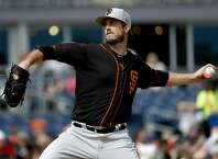San Francisco Giants pitcher Drew Pomeranz throws against the San Diego Padres during the first inning of a spring training baseball game, Saturday, March 2, 2019, in Peoria, Ariz. (AP Photo/Matt York)