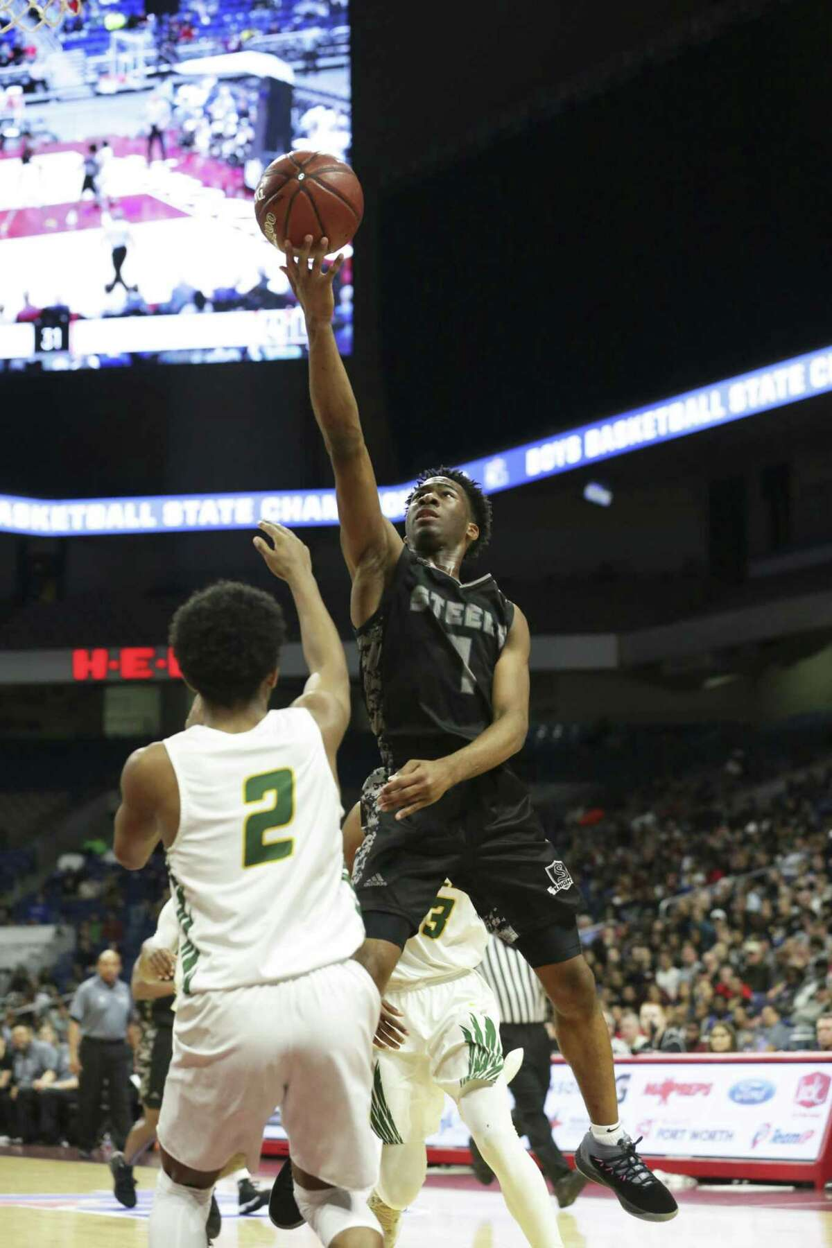 DeVaughn Rider gets off a runner over Marion Williams as Steele plays Klein Forest in the Class 6A boys state semifinal basketball game at the Alamodome on March 8, 2019.
