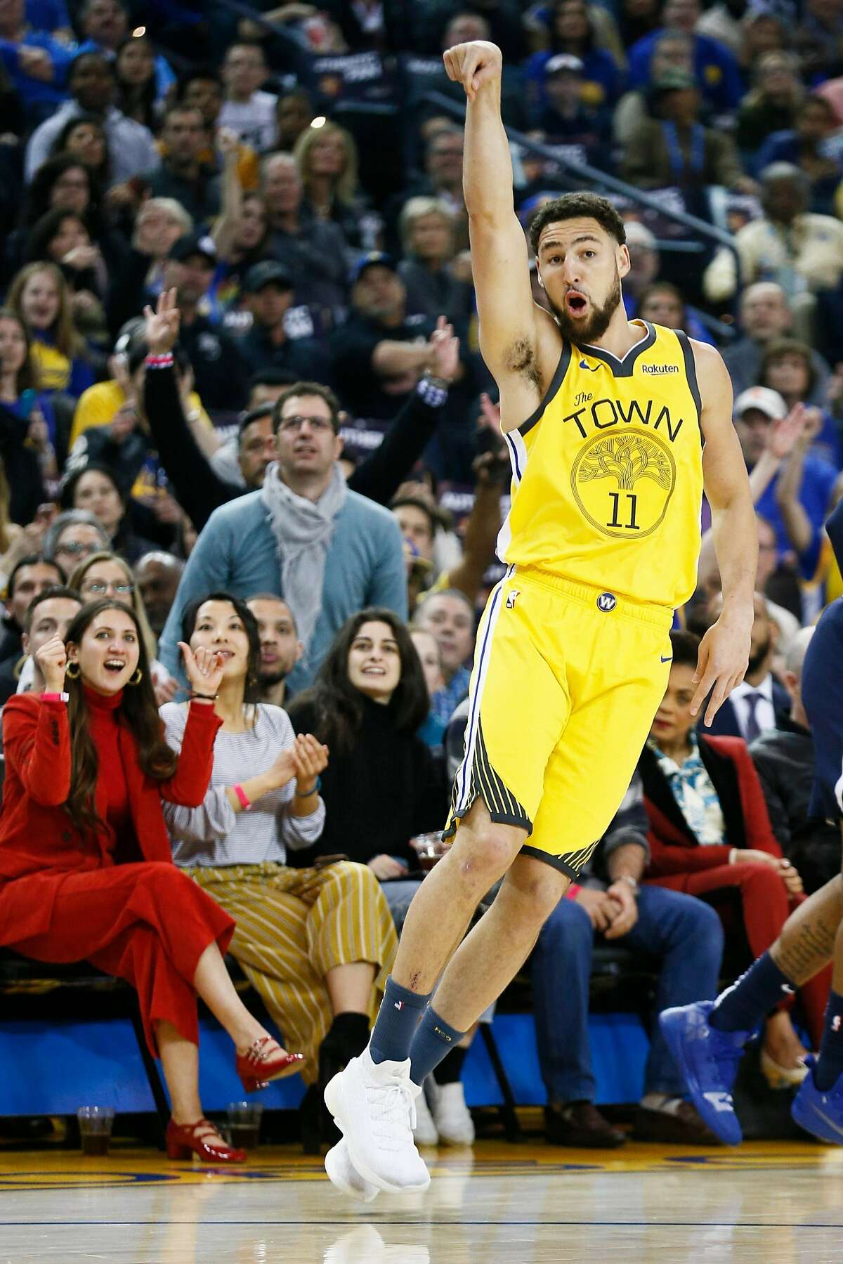 Golden State Warriors guard Klay Thompson (11) shoots a three-point field goal in the first half of an NBA game against the Denver Nuggets at Oracle Arena on Friday, March 8, 2019, in Oakland, Calif.