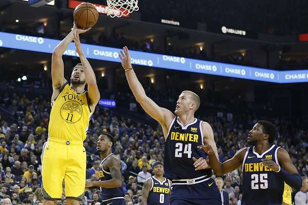 098ddd1f61f9 1of2Golden State Warriors guard Klay Thompson (11) makes the two-point  field goal in the first half of an NBA game against the Denver Nuggets at  Oracle ...
