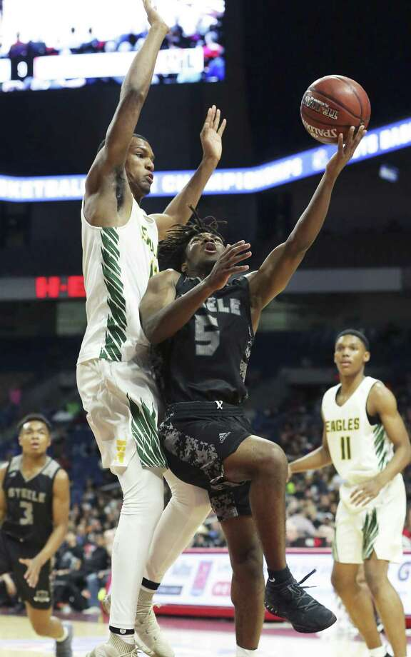 Quincey Sheperd tries a layup against Eagle center Calvin Solomon as Steele plays Klein Forest in the Class 6A boys state semifinal basketball game at the Alamodome on March 8, 2019. Photo: Tom Reel, Staff / Staff Photographer / 2019 SAN ANTONIO EXPRESS-NEWS
