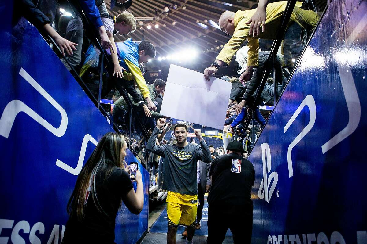 Golden State Warriors guard Klay Thompson (11) heads to the locker room following the Warriors' win against the Denver Nuggets in an NBA game at Oracle Arena on Friday, March 8, 2019, in Oakland, Calif.