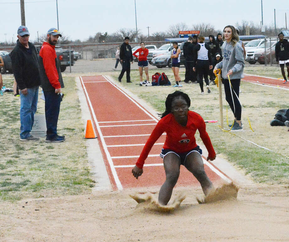 Plainview's Laderika Kendrick lands in the sand after completing her triple jump during the Bulldogs Relays on Friday in Plainview. Photo: Alexis Cubit/Plainview Herald