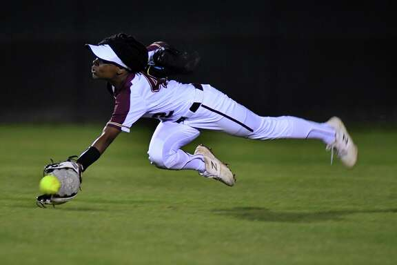 Summer Creek sophomore centerfielder Tyra Parker goes vertical to make a play against Kingwood in the top pf the 4th inning of their District 22-6A matchup at SCHS on March 8, 2019.
