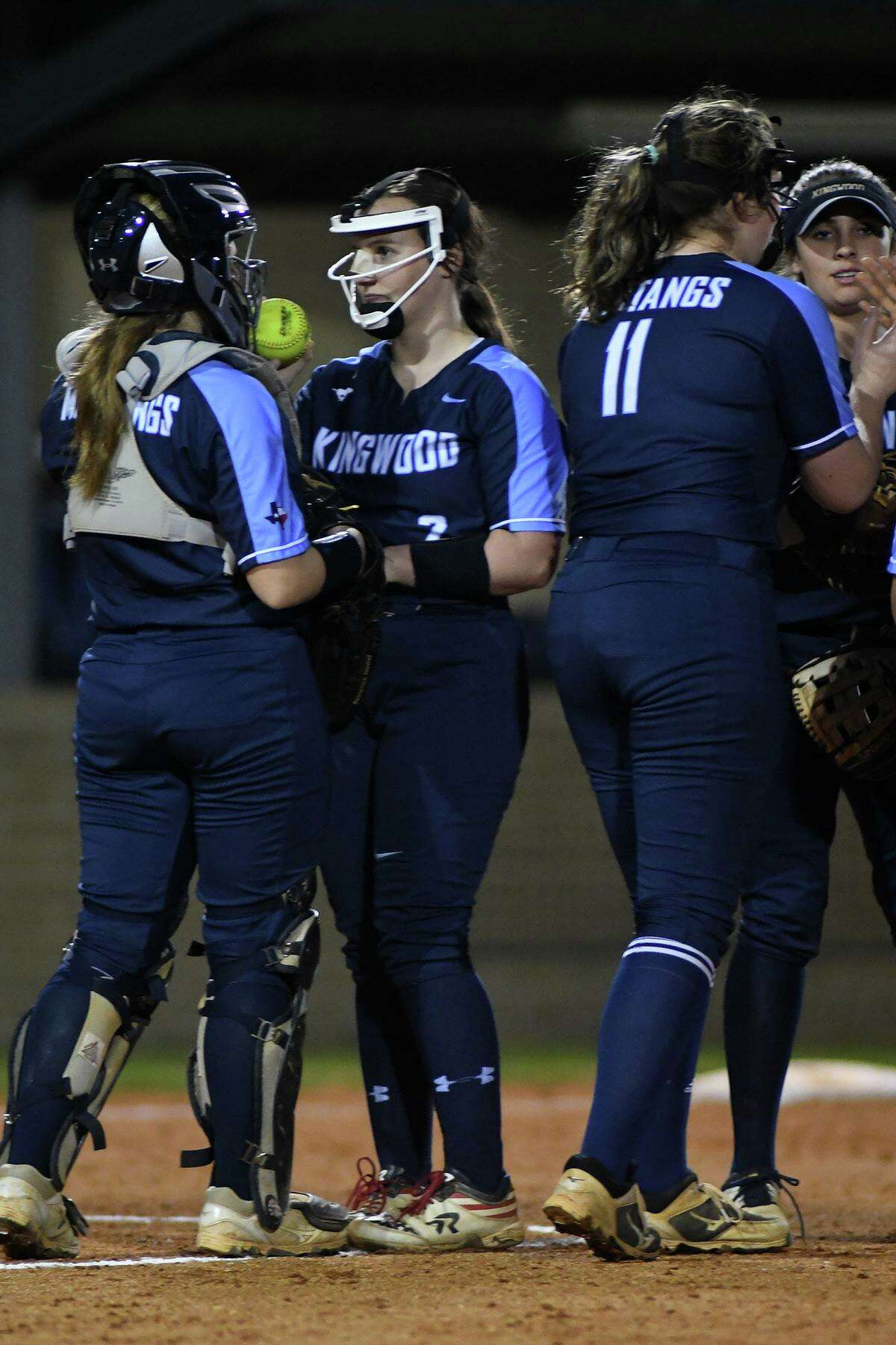 Kingwood catcher Taylor Vannett, from left, pitcher Mary Martinez, 1st baseman Bri Windham, and 3rd baseman Maddie Brewer get ready to play defense against Summer Creek in the bottom of the 2nd inning of their District 22-6A matchup at SCHS on March 8, 2019.