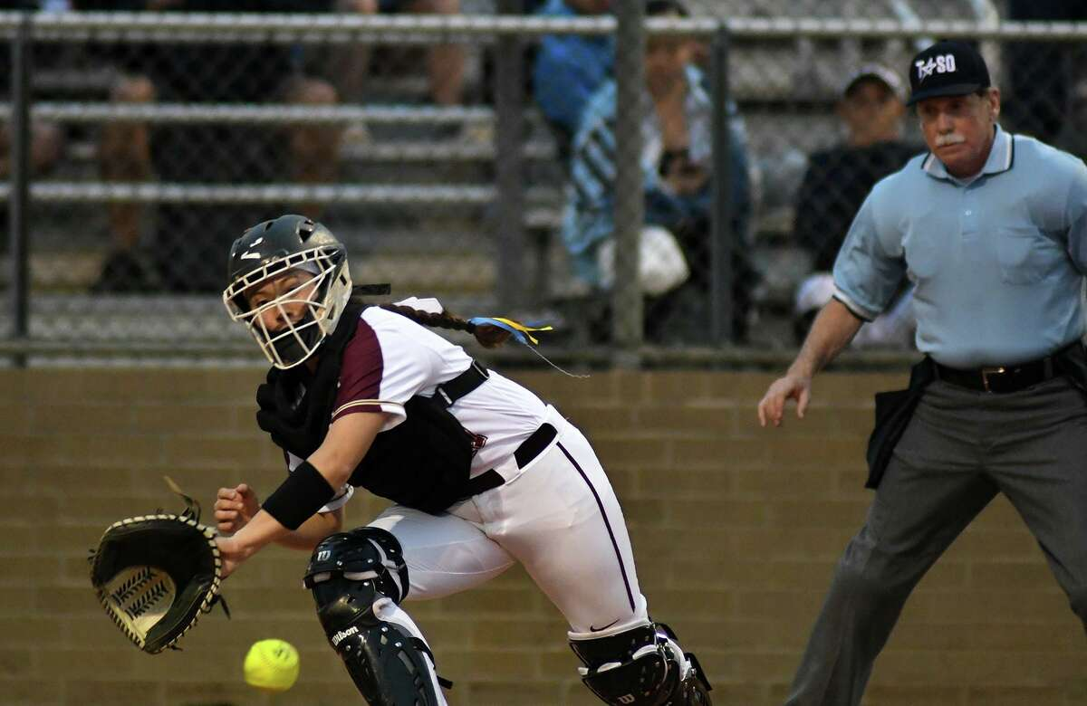 Summer Creek catcher Derika Castillo makes a play atthe plate against Kingwood during the top of the 1st inning of their District 22-6A matchup at SCHS on March 8, 2019.