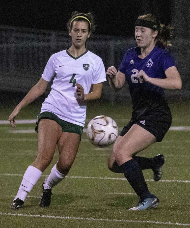 Kingwood Park junior Marilyn Perri (4) passes in front of Montgomery senior Ashton Jilek (21) during a girls soccer game Tuesday, Jan. 15, 2019 at Montgomery High School in Montgomery. Photo: Cody Bahn, Houston Chronicle / Staff Photographer / © 2018 Houston Chronicle
