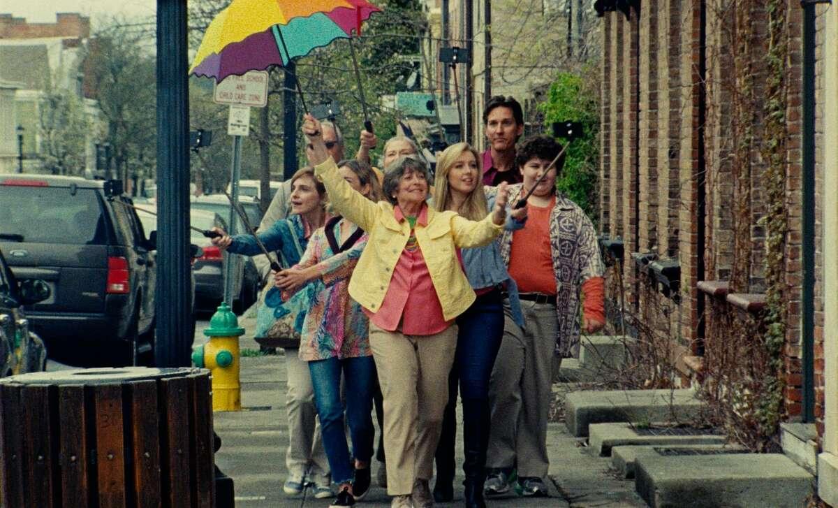 Tour leader (Ann Davies) with tourists