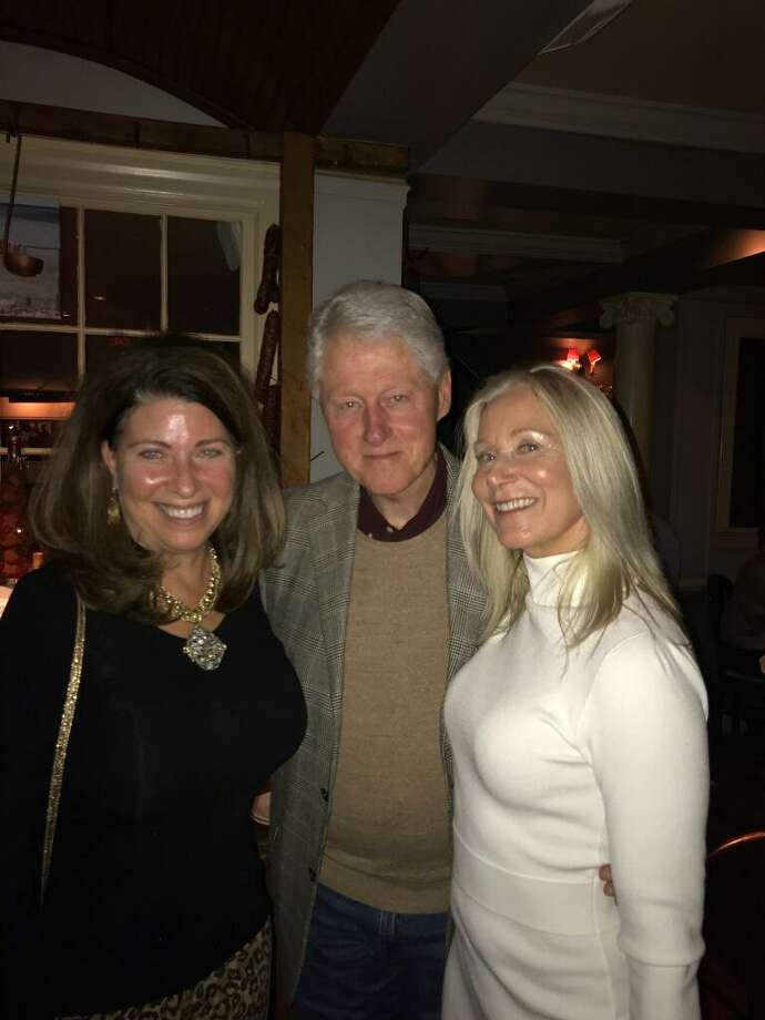 Greenwich residents Linda Castellana and Maryjane Weiss with former President Bill Clinton at Polpo Restaurant in Greenwich last week. Photo: Contributed /