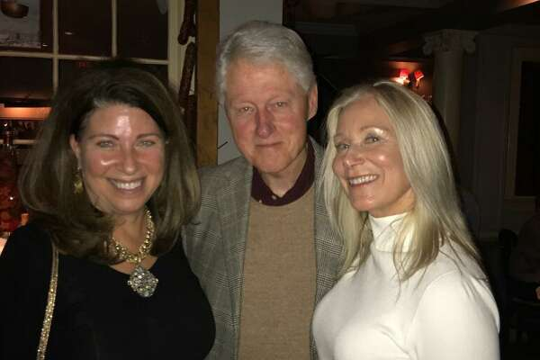 Greenwich residents Linda Castellana and Maryjane Weiss with former President Bill Clinton at Polpo Restaurant in Greenwich last week.