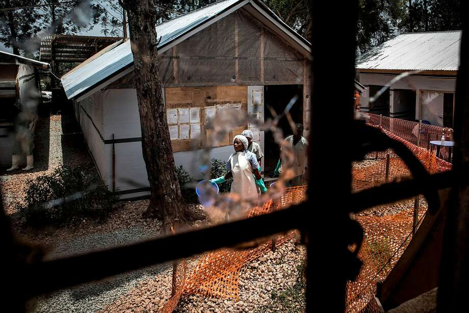Health workers are seen through a bullet hole in a window of an Ebola treatment center after an attack by gunmen in Butembo city. Dozens of armed groups are active in eastern Congo. Photo: John Wessels / AFP / Getty Images