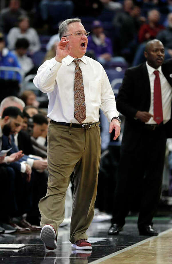 SIUC coach Barry Hinson works the sidelines during the Salukis' MVC Tourney game against Northern Iowa on Friday in St. Louis. Photo: Associated Press