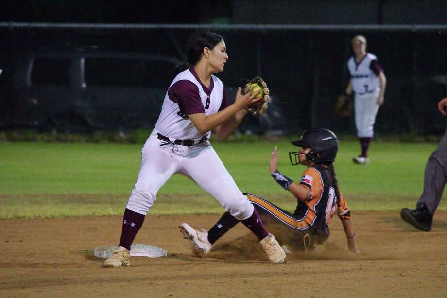 Alvin's Evany Gonzalez (12) slides to beat the throw to Clear Creek's Loran Salinas (19) at second base Friday in a District 24-6A softball game at Clear Creek. Photo: Kirk Sides / Staff Photographer / © 2019 Kirk Sides / Houston Chronicle