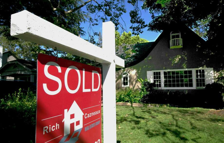 """FILE - This Wednesday, July 5, 2017, file photo, shows a """"Sold"""" sign displayed in front of a house in Sacramento, Calif. A home of your own comes with new freedom and more responsibility. (AP Photo/Rich Pedroncelli, File) Photo: Rich Pedroncelli / Copyright 2017 The Associated Press. All rights reserved."""