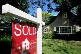 """FILE - This Wednesday, July 5, 2017, file photo, shows a """"Sold"""" sign displayed in front of a house in Sacramento, Calif. A home of your own comes with new freedom and more responsibility. (AP Photo/Rich Pedroncelli, File)"""