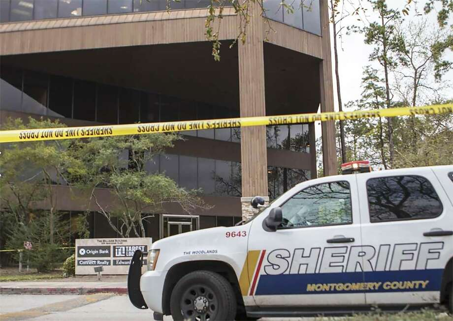 Montgomery County Sheriff's Office officials investigate a shooting Friday, March 8, 2019 at the Millside Building in The Woodlands. Photo: Cody Bahn/Staff Photographer / Houston Chronicle