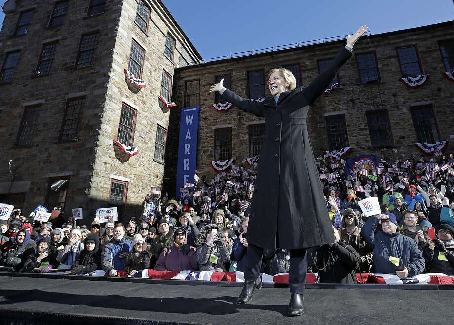 "Democratic Sen. Elizabeth Warren takes the stage in Lawrence, Mass., while Dolly Parton's ""9 to 5"" plays, suggesting she would give workers a fairer shake. Photo: Elise Amendola / Associated Press"