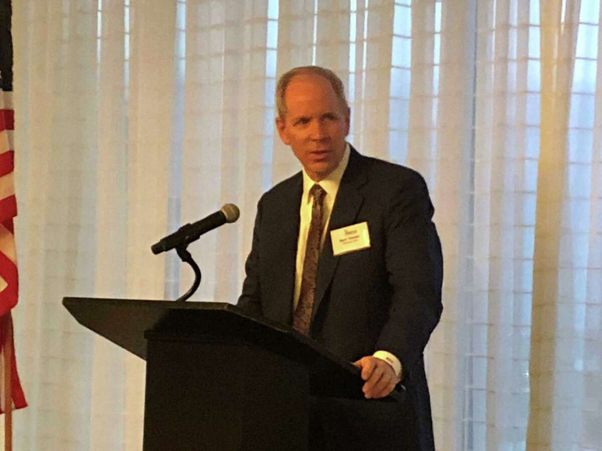 University Lands CEO Mark Houser speaking Wednesday before the Houston Wildcatters. The state-owned mineral leasing and royalty company has signed a deal with Fountain Quail Energy Services for a number of water-related services on oil leases it controls in the Permian Basin's Andrews County.