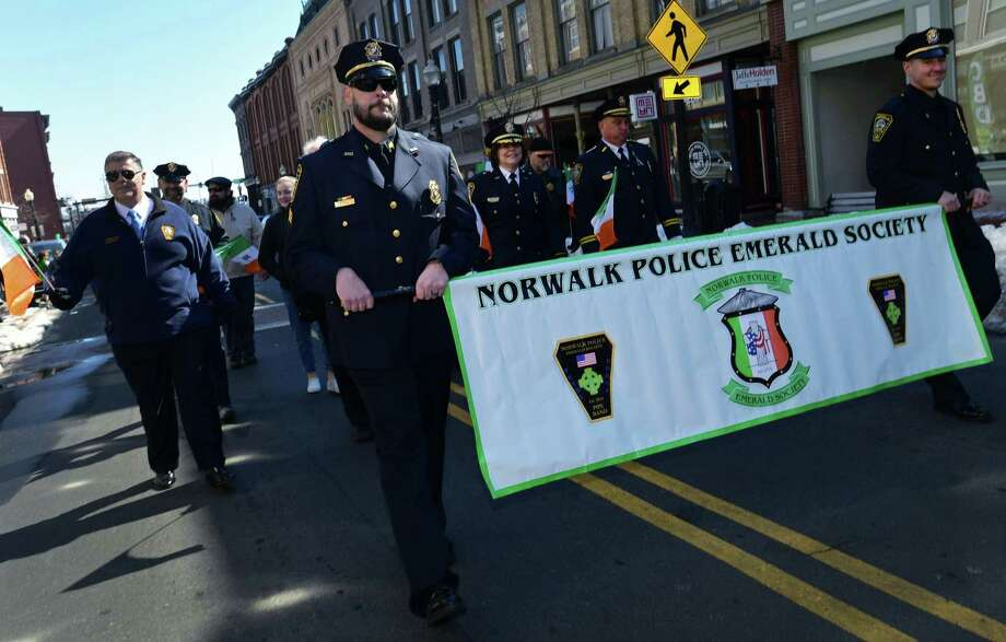 Norwalk police hold the Norwalk Police Emerald Society banner during the 4th Annual St. Patrick's Day Parade Saturday, March 9, 2019, in Norwalk, Conn. The parade started from Veterans Memorial Park proceeded down Washington Street and turnd up North Main Street, ending at O'Neill's Pub. Photo: Erik Trautmann / Hearst Connecticut Media / Norwalk Hour