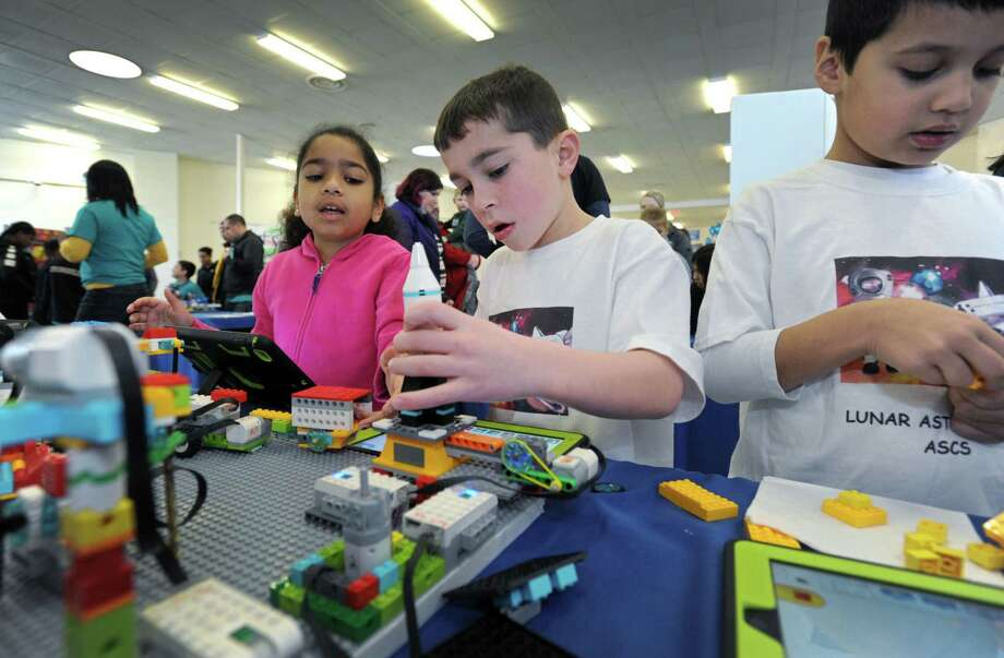 All Saints Catholic School 2nd graders Isabella Oliver, Cody DiIorio and Joshua Elriachi work on their project during the Lego Robotics Competition and Expo for students in Grades K-3 Saturday, March 9, 2019, at All Saints Catholic School, in Norwalk, Conn. Eight schools from districts all over Fairfield County competed. Photo: Erik Trautmann / Hearst Connecticut Media / Norwalk Hour
