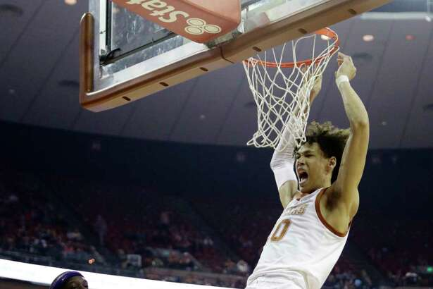 Texas forward Jaxson Hayes (10) scores against TCU during the second half of an NCAA college basketball game, Saturday, March 9, 2019, in Austin, Texas. (AP Photo/Eric Gay)