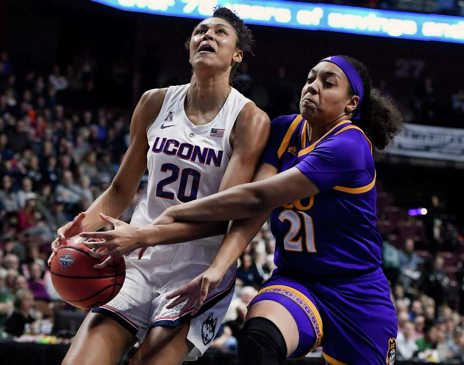 ECU's Salita Greene, right, fouls UConn's Olivia Nelson-Ododa during Saturday's AAC quarterfinal game at Mohegan Sun Arena. Photo: Jessica Hill / Associated Press / Copyright 2019 The Associated Press. All rights reserved