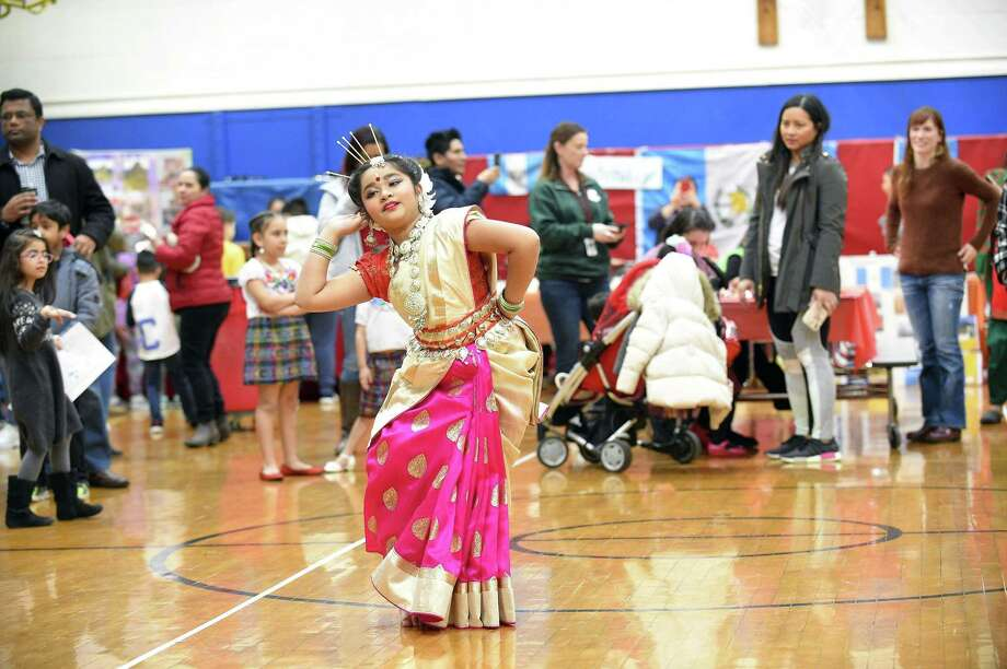 Nerja Sarker, a third-grader at K.T. Murphy School, performs a dance that is native to her Bangladesh heritage during the 9th Annual Multi-Cultural Fair on Saturday, March 9, 2019 in Stamford, Connecticut. The fair was created to educate our children about our cultural differences that makes us all unique. It is a celebration of many diverse cultures represented by our schools families from 17 countries around the world. Attendees were treated to performances by students, cultural foods prepared by families of K.T. Murphy School, Henna Tattooing and much more, as they learned about the diversity of the many students and their heritage. Photo: Matthew Brown / Hearst Connecticut Media / Stamford Advocate