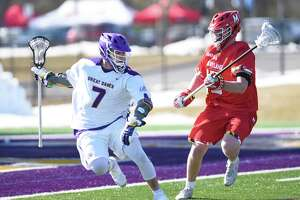 UAlbany attack Mitch Laffin cradles the ball during a game against Maryland on Saturday, March 9, 2019 at Casey Stadium in Albany, NY. (Phoebe Sheehan/Times Union)
